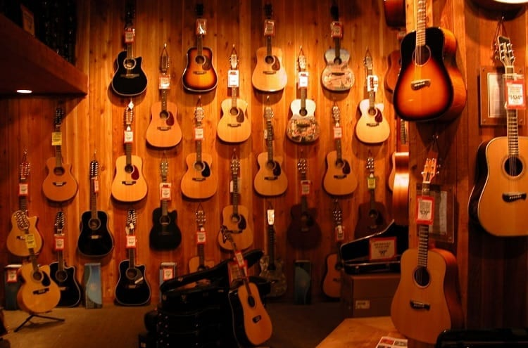 wall of guitars in music shop
