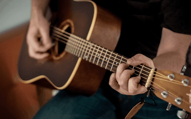 learning to play acoustic guitar