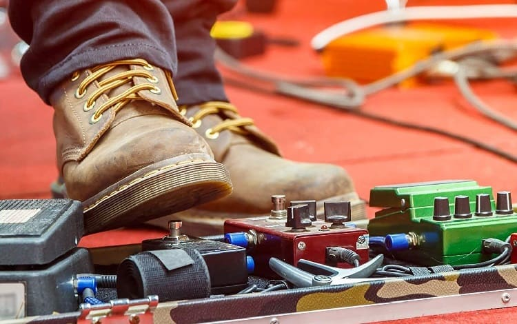 foot on a fuzz pedal